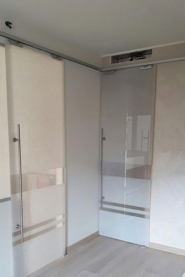 Porte scorrevoli in vetro satinato per studio legale a milano mdb portas - Porte a vetro scorrevoli esterno muro ...